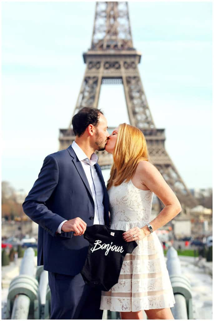 A cute anniversary and baby announcement photo session by the Eiffel Tower in Paris, France